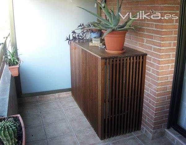 Bonitas ideas para ocultar el aire acondicionado exterior for Mueble para plantas exterior